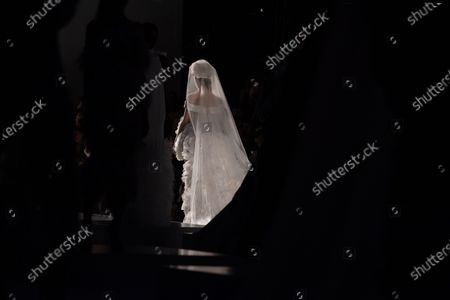 Stock Photo of A model presents a bridal gown from the Spring/Summer 2020 Haute Couture collection of British designers Tamara Ralph and Michael Russo for their label Ralph and Russo during the Paris Fashion Week, in Paris, France, 20 January 2020. The presentation of the Haute Couture collections runs from 20 to 23 January.