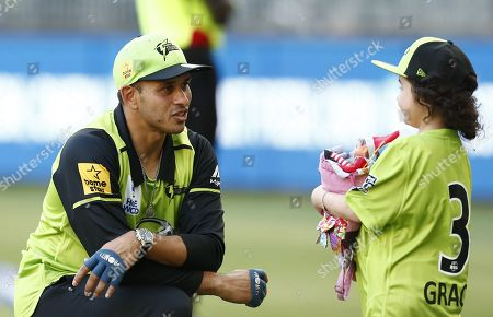 Usman Khawaja of Sydney Thunder chats with Grace before the start of the match