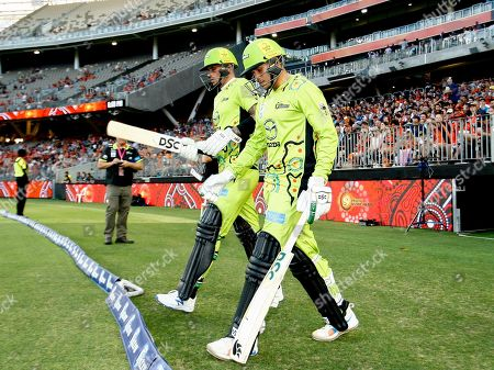 Usman Khawaja and Alex Hales of the Sydney Thunder walk out to open the innings for the Thunder