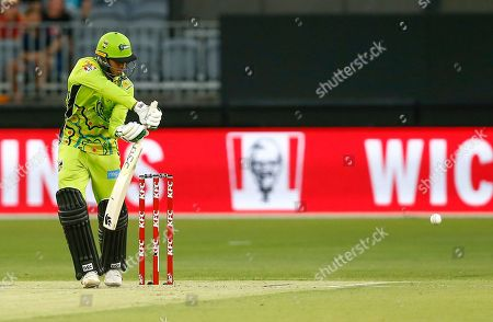 Stock Image of Usman Khawaja of Sydney Thunder plays to the off side during his innings