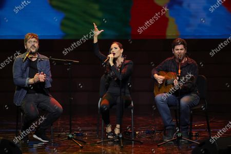 Stock Picture of 'Estopa' members, brothers David (L) and Jose Manuel Muñoz (R) perform together with India Martinez (C) after receiving the 'Best Group' award during the Odeon Music Awards gala at the Royal Theater in Madrid, Spain, 20 January 2020. The Odeon awards honor the best Spanish albums and singers of the previous year.