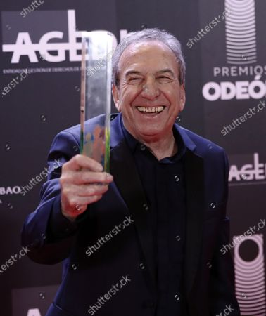 Jose Luis Perales poses after receiving the Honorific award during the Odeon Music Awards gala at the Royal Theater in Madrid, Spain, 20 January 2020. The Odeon awards honor the best Spanish albums and singers of the previous year.