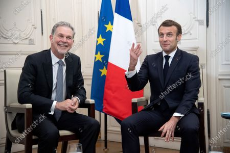 Stock Picture of Netflix CEO Reed Hastings and French President Emmanuel Macron