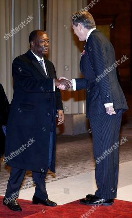 Ivory Coast's President Alassane Ouattara arrives at Buckingham Palace for a reception to mark the UK-Africa Investment Summit hosted by Britain's Prince William and Kate, the Duchess of Cambridge on behalf of the Queen, in London