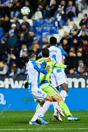 Kenneth Josiah Omeruo of CD Leganes and Jorge Molina of Getafe FC