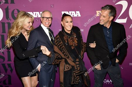 Stock Picture of Christie Brinkley, Tommy Hilfiger, Donna Karan, Kenneth Cole. Model Christie Brinkley, left, poses with designers Tommy Hilfiger, Donna Karan and Kenneth Cole, right, at the 2019 Footwear News Achievement Awards at the IAC Building, in New York