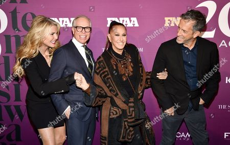 Stock Photo of Christie Brinkley, Tommy Hilfiger, Donna Karan, Kenneth Cole. Model Christie Brinkley, left, poses with designers Tommy Hilfiger, Donna Karan and Kenneth Cole, right, at the 2019 Footwear News Achievement Awards at the IAC Building, in New York