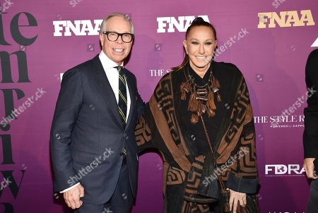 Tommy Hilfiger, Donna Karan. Designers Tommy Hilfiger, left, and Donna Karan pose together at the 2019 Footwear News Achievement Awards at the IAC Building, in New York