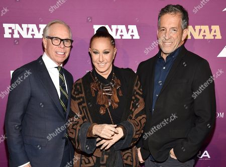 Tommy Hilfiger, Donna Karan, Kenneth Cole. Designers Tommy Hilfiger, left, Donna Karan and Kenneth Cole pose together at the 2019 Footwear News Achievement Awards at the IAC Building, in New York