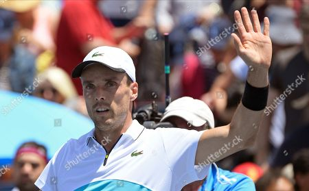 Stock Photo of Spain's Roberto Bautista Agut celebrates after defeating compatriot Feliciano Lopez during their first round singles match at the Australian Open tennis championship in Melbourne, Australia