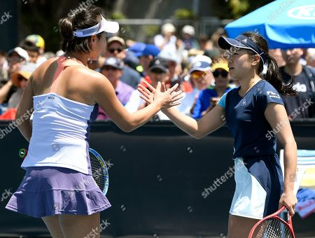 Japan's Nao Hibino, right, is congratulated by China's Peng Shuai after winning their first round singles match at the Australian Open tennis championship in Melbourne, Australia