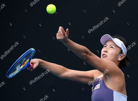 China's Peng Shuai serves to Japan's Nao Hibino during their first round singles match at the Australian Open tennis championship in Melbourne, Australia