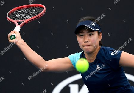 Japan's Nao Hibino makes a forehand return to China's Peng Shuai during their first round singles match at the Australian Open tennis championship in Melbourne, Australia