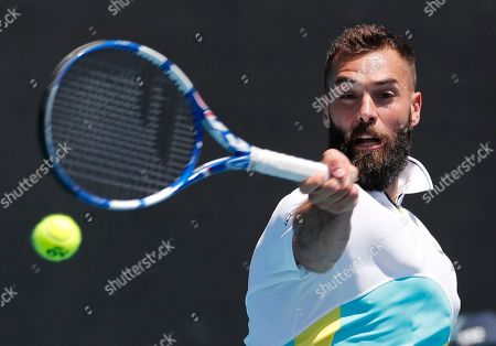 France's Benoit Paire makes a forehand return to Germany's Cedrik-Marcel Stebe during their first round singles match at the Australian Open tennis championship in Melbourne, Australia