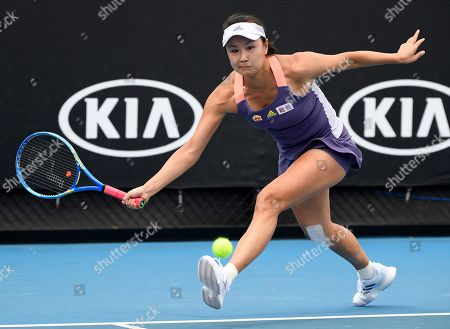 China's Peng Shuai makes a forehand return to Japan's Nao Hibino during their first round singles match at the Australian Open tennis championship in Melbourne, Australia