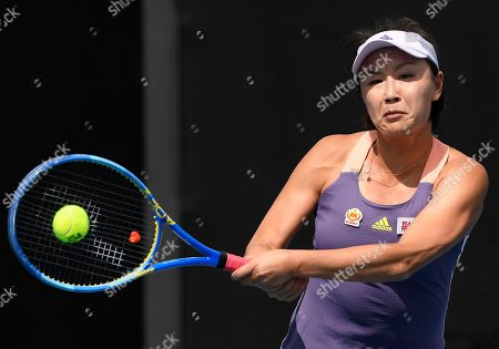 China's Peng Shuai makes a backhand return to Japan's Nao Hibino during their first round singles match at the Australian Open tennis championship in Melbourne, Australia