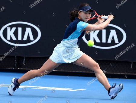 Japan's Nao Hibino makes a backhand return to China's Peng Shuai during their first round singles match at the Australian Open tennis championship in Melbourne, Australia