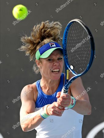 Germany's Laura Siegemund makes a backhand return to Coco Vandeweghe U.S. during their first round singles match at the Australian Open tennis championship in Melbourne, Australia