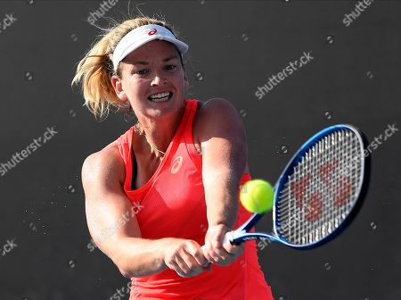 Coco Vandeweghe U.S. makes a backhand return to Germany's Laura Siegemund during their first round singles match at the Australian Open tennis championship in Melbourne, Australia