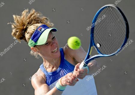 Germany's Laura Siegemund makes a backhand return to Coco Vandeweghe of the U.S. during their first round singles match at the Australian Open tennis championship in Melbourne, Australia