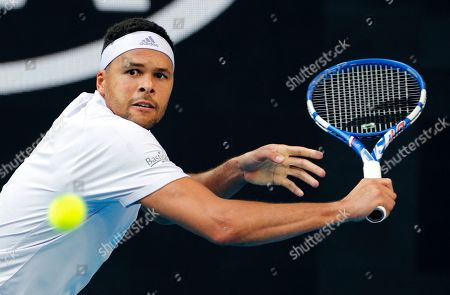 France's Jo-Wilfried Tsonga makes a backhand return to Australia's Alexei Popyrin during their first round singles match at the Australian Open tennis championship in Melbourne, Australia