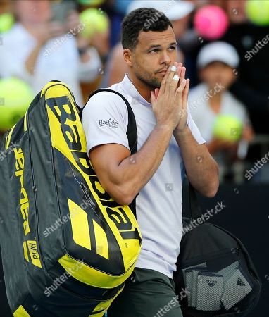 France's Jo-Wilfried Tsonga gestures to the crowd after he retired injured from his first round singles match against Australia's Alexei Popyrin at the Australian Open tennis championship in Melbourne, Australia