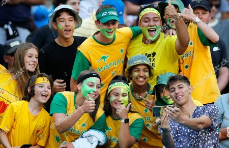 Australia's Alexei Popyrin takes selfies with fans after France's Jo-Wilfried Tsonga retired injured from their first round singles match against at the Australian Open tennis championship in Melbourne, Australia