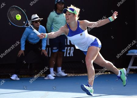 Germany's Laura Siegemund makes a forehand return to Coco Vandeweghe of the U.S. during their first round singles match at the Australian Open tennis championship in Melbourne, Australia