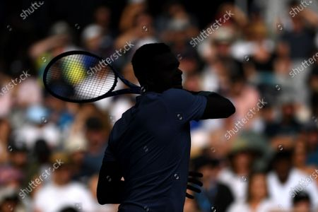 Jo-Wilfried Tsonga of France in action against Alexei Popyrin of Australia during their first round match at the Australian Open tennis tournament at Melbourne Park in Melbourne, Australia, 21 January 2020.