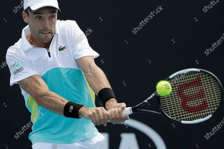 Stock Picture of Roberto Bautista Agut of Spain in action during his men's singles first round match against Feliciano Lopez of Spain at the Australian Open Grand Slam tennis tournament in Melbourne, Australia, 21 January 2020.