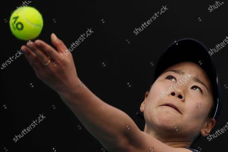 Nao Hibino of Japan serves during her women's singles first round match against Peng Shuai of China at the Australian Open Grand Slam tennis tournament in Melbourne, Australia, 21 January 2020.