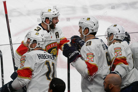Florida Panthers defenseman Keith Yandle (3) celebrates with Florida Panthers left wing Jonathan Huberdeau (11), Florida Panthers center Brian Boyle (9) and Florida Panthers defenseman Mark Pysyk after Yandle scored against the Minnesota Wild during the first period of an NHL hockey game, in St. Paul, Minn
