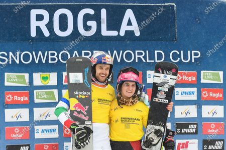 Stock Image of World Cup leaders Roland Fischnaller of Italy and Ramona Hofmeister of Germany pose on the podium