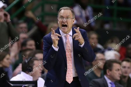 Oklahoma head coach Lon Kruger calls a play to his players in the second half of an NCAA college basketball game against Baylor, in Waco, Texas