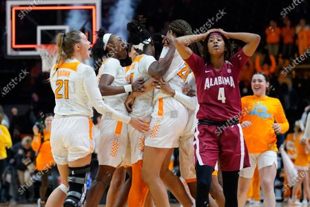 Tennessee Lady Vols player celebrate a last second wining shot while Cierra Johnson #4 of the Alabama Crimson Tide reacts during the NCAA basketball game between the University of Tennessee Lady Volunteers and University of Alabama Crimson Tide at Thompson Boling Arena in Knoxville TN Tim Gangloff/CSM