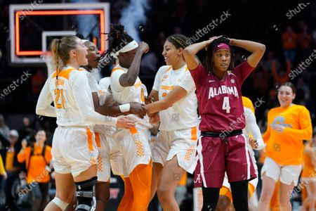 Stock Photo of Tennessee Lady Vols player celebrate a last second wining shot while Cierra Johnson #4 of the Alabama Crimson Tide reacts during the NCAA basketball game between the University of Tennessee Lady Volunteers and University of Alabama Crimson Tide at Thompson Boling Arena in Knoxville TN Tim Gangloff/CSM