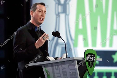 Stock Picture of Kyle Busch speaks as he is honored at the NASCAR Cup Series Awards in Nashville, Tenn. Two months removed from that second title, Busch is confident _ adamant almost _ that he will close his career at minimum tied with greats Richard Petty, Dale Earnhardt and Jimmie Johnson