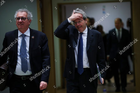 Paolo Gentiloni, Pierre Gramegna. European Commissioner for Economy Paolo Gentiloni, right, and Luxembourg's Finance Minister Pierre Gramegna arrive to an European Finance Ministers meeting at the Europa building in Brussels
