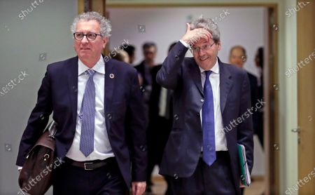 Luxembourg's Finance Minister Pierre Gramegna (L) and European Commissioner for Economy Paolo Gentiloni (R) attend a Finance Ministers' Economic and Financial Affairs Council (ECOFIN) meeting in Brussels, Belgium, 21 January 2020.