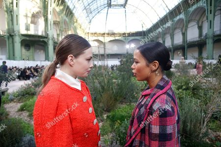 Actress Kristine Froseth, left, talks with Canadian actress Taylor Russell before Chanel Haute Couture Spring/Summer 2020 fashion collection, Tuesday Jan.21, 2020 in Paris