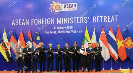 (L-R) Foreign ministers of the Association of Southeast Asian Nations (ASEAN): Malaysia's Saifuddin Abdullah, Myanmar's Union Minister for International Cooperation Kyaw Tin, Philippines' Teodoro Locsin, Singapore's Vivian Balakrishnan, Thailand's Don Pramudwinai, Vietnam's Pham Binh Minh, Brunei's Ministry of Foreign Affairs Erywan bin Mohd Yusof, Cambodia's Prak Sokhonn, Indonesia's Retno Marsudi, Laos' Saleumxay Kommasith, ASEAN Secretary-General Lim Jock Hoi pose for a group photo during the ASEAN Foreign Ministers' Retreat in Nha Trang city, Khanh Hoa province, Vietnam 17 January 2020.