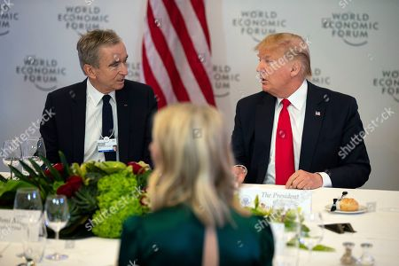 Donald Trump, Bernard Arnault. President Donald Trump speaks with LVMH CEO Bernard Arnault during a dinner with global business leaders at the World Economic Forum, in Davos, Switzerland