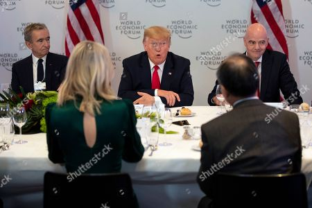 Donald Trump, Bernard Arnault, Gianni Infantino. LVMH CEO Bernard Arnault, left, and FIFA president Gianni Infantino, right, listen as President Donald Trump speaks during a dinner with global business leaders at the World Economic Forum, in Davos, Switzerland