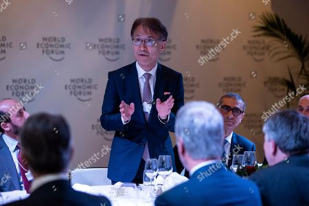 Stock Photo of Sony CEO Kenichiro Yoshida speaks during a dinner with President Donald Trump and global business leaders at the World Economic Forum, in Davos, Switzerland