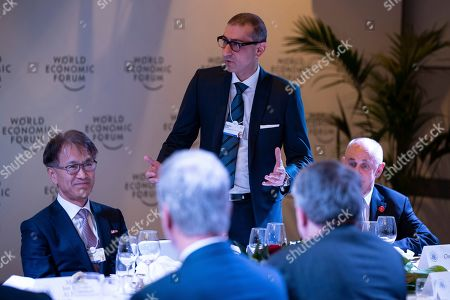 Stock Picture of Kenichiro Yoshida, Rajeev Suri. Sony CEO Kenichiro Yoshida, left, listens as Nokia CEO Rajeev Suri speaks during a dinner with President Donald Trump and global business leaders at the World Economic Forum, in Davos, Switzerland