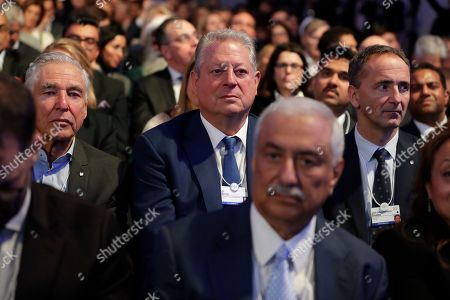 Donald Trump, Al Gore. Former U.S. Vice President Al Gore, center, sits in the audience and listens as President Donald Trump delivers the opening remarks at the World Economic Forum, in Davos