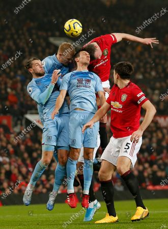 Phil Jones of Manchester United tries to head the ball into the net through a host of Burnley players