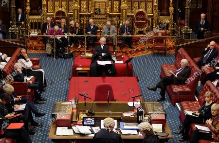 The Lord Speaker Lord Fowler, centre, listens inside the House of Lords as the European Withdrawal Agreement Bill is debated in London, . Britain's House of Lords is considering the European Withdrawal Agreement Bill, which is due to pass through its final stages before returning to the House of Commons