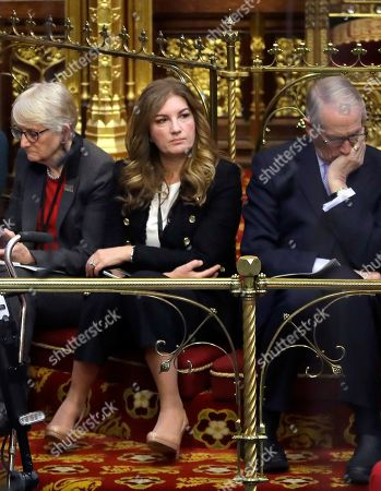Baroness Brady, centre, listens inside the House of Lords as the European Withdrawal Agreement Bill is debated in London, . Britain's House of Lords is considering the European Withdrawal Agreement Bill, which is due to pass through its final stages before returning to the House of Commons