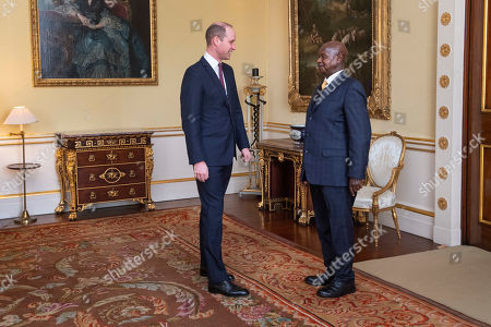 Stock Image of Prince William receives the President of Uganda Yoweri Museveni during an audience at Buckingham Palace, London.